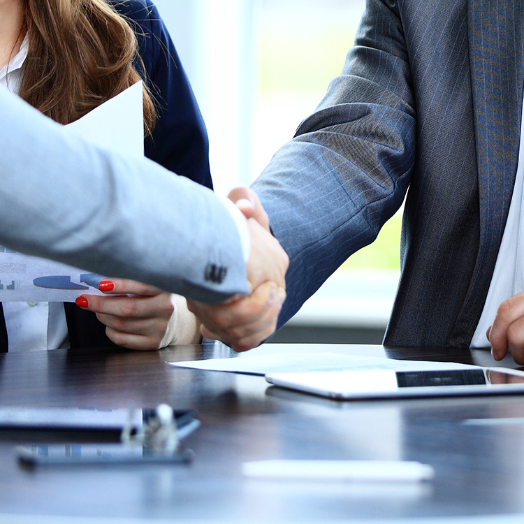 A private investigator shaking hands with a corporate client