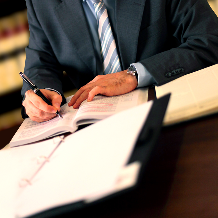 An attorney signing paperwork