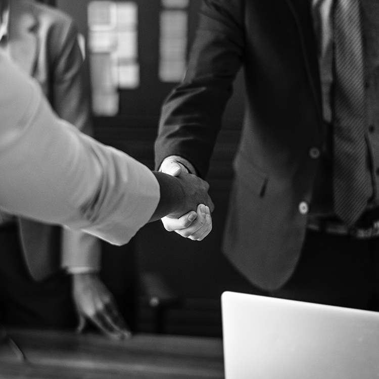 A private investigator shaking hands with a client after they closed a successful case